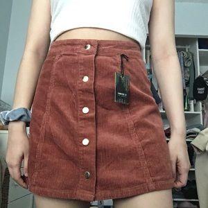 Rust corduroy skirt a line button up